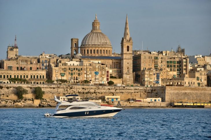 luxury yacht with Valletta in the background