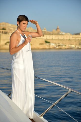 woman aboard a Sunseeker yacht in Grand Harbour Malta