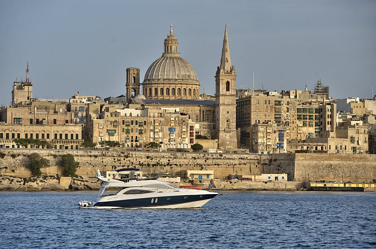 Sunseeker yacht sailing Valletta Grand Harbour