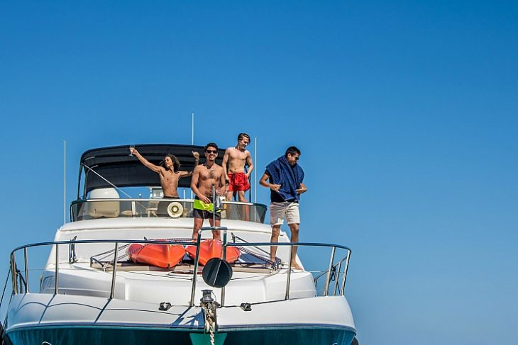 Young men partying on a luxury Sunseeker yacht in Malta
