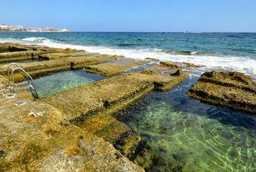 rectangular rock-cut pools for swimming at Fond Ghadir Bay in Malta