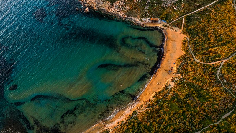aerial photo of the golden sand and blue waters of Golden Bay Malta