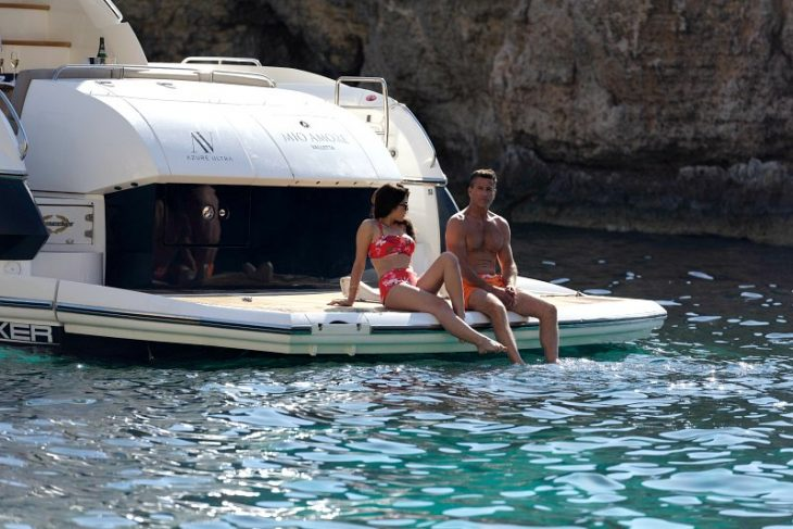 couple in bathing costumes on board a luxury yacht in Malta