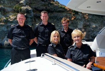 Crew members on board a Sunseeker yacht in Malta