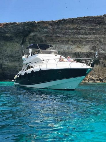Sunseeker yacht in Comino Malta