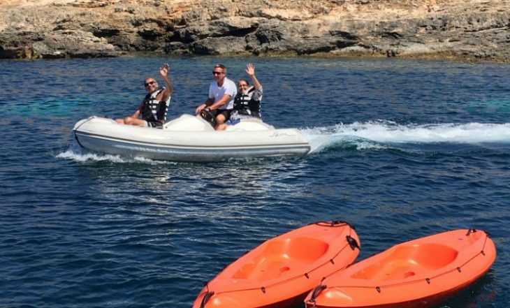 charter guests riding a jet tender in the Mediterranean