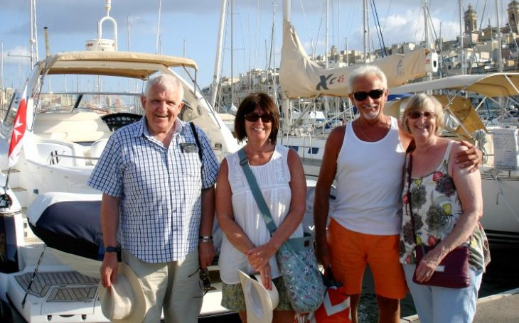 guests on a Mediterranean day charter at Birgu Marina pontoon