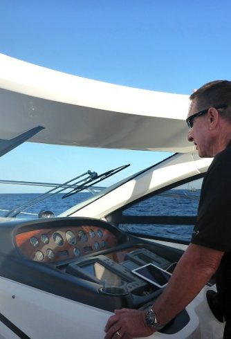 Captain Roger trying out motor yacht Senda Dos