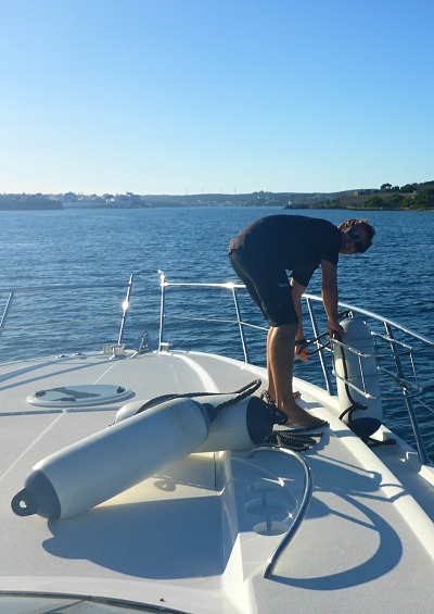 deckhand working on board a motor yacht