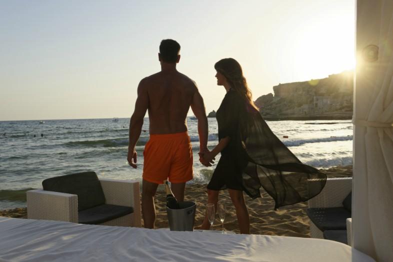 couple watching sunset at Golden Bay Malta