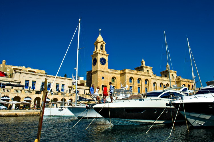 people on board a yacht at Birgu Marina in Malta
