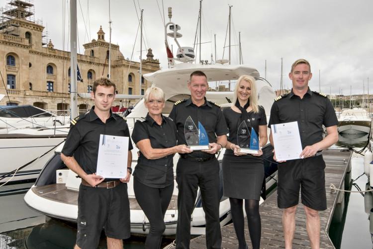 Azure Ultra crew holding yacht awards on Birgu pontoon