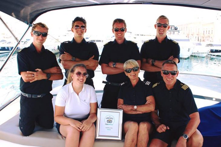 Azure Ultra crew posing with TripAdvisor Certificate of Excellence