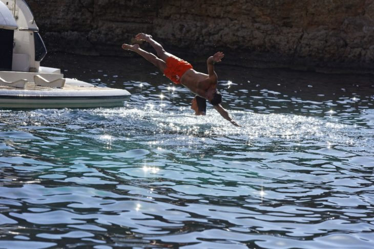Man-diving-off-yacht